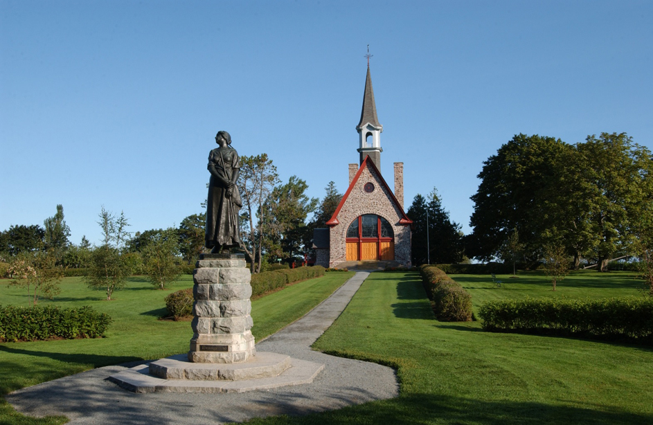 Evangeline statue and church at Grand Pré National Historic Site near Wolfville in the Annapolis Valley